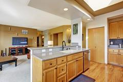 house interior. kitchen area and living room - stock photo
