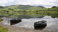 Boats Watendlath Tarn Lake District Cumbria England close to Derwent Water Stock Footage