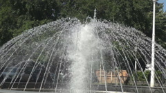 Closeup beautiful water fountain pumping water, fountain in city park, cooling Stock Footage