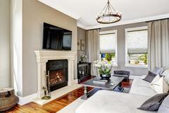 Impressive living room interior in luxury house Stock Photos