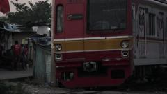 Train passing by in Jakarta - stock footage