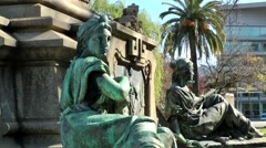 Spain Galicia City of Vigo 011 sitting and lying statues at a plinth of monument Stock Footage