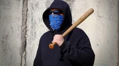 Man with a baseball bat near the wall Stock Footage