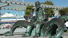 Spain Galicia City of Vigo 014 monument in harbor, Jules Verne sits on octopus Stock Footage