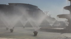 Close-up water spray fountain, cooling city atmosphere in heatwave summer days - stock footage