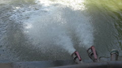 Water pipes filling a lake, opened water pumps, industrial scene powerful flow - stock footage