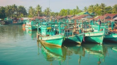 Sihanoukville, cambodia - circa dec 2013: wooden fishing boats in river delta Stock Footage