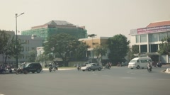Phnom penh, cambodia - 29 dec 2013: normal traffic through a large intersecti Stock Footage