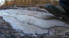Breaking the ice on the forest dirt road in Poland. Stock Footage