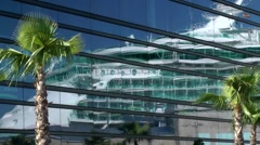 Stock Video Footage of Spain Galicia City of Vigo 018 cruise ship mirror image in glass facade