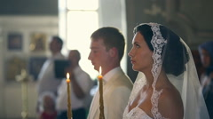 Newlyweds at the wedding in the Orthodox Church - stock footage
