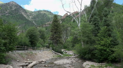 Mountain campground and rocky river stream Stock Footage