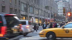 Heavy traffic street New York City car pass pedestrian people wait stop yellow  Stock Footage