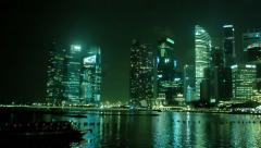 Singapore - circa jan 2014: pleasure boats near the office towers of business Stock Footage