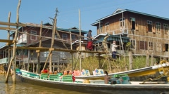 Inle lake, myanmar - circa jan 2014: going on a boat through the village on t Stock Footage
