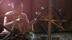 Inle lake, myanmar - circa jan 2014: elderly woman spinning in the traditiona Stock Footage
