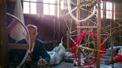 Inle lake, myanmar - circa jan 2014: local old woman working at a textile fac Stock Footage