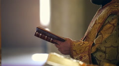 Reading the Holy Gospel. Hands Orthodox priest turns the page - stock footage