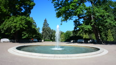 Fountain in beautiful green city park Stock Footage