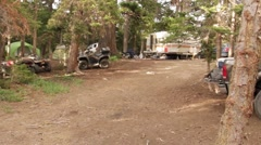 Stock Video Footage of Camping Site with RV and 4 Wheelers