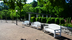 City park with white benches Stock Footage