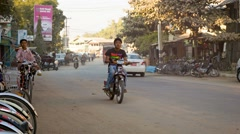 Bagan, myanmar - 11 jan 2014: common asian transport traffic on a  street wit Stock Footage