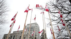 Canadian flags move in the Vancouver wind - 2 shots Stock Footage