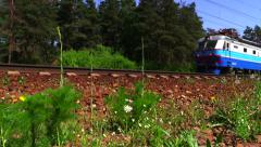 Passenger train rides the on rails in the forest. Russian Railways. Stock Footage