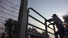 Stock Video Footage of COWBOY RANCHER, pasture gate