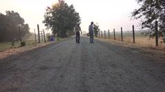 COWBOY RANCHER two men walking Stock Footage