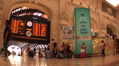Railway station indicator board,passengers,travellers and commuters TIME LAPSE Stock Footage