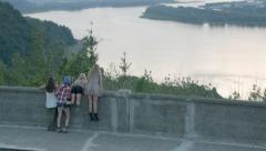 Teens At Viewpoint, They Climb The Wall, Then Run And Piggyback Ride Away Stock Footage