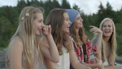 Group of 4 Friends Sit On Car To Watch The Sunset, They Rock Out And Dance Stock Footage