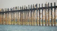 Mandalay, myanmar - 13 jan 2014: local fisherman catches fish near teak woode Stock Footage