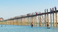 Mandalay, myanmar - 13 jan 2014: large wooden bridge. local fishing and swim. Stock Footage