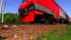 Red-gray RZD Suburban train (russian railway) rides in the forest. Stock Footage