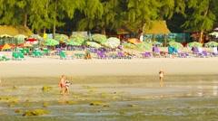 Phuket, thailand - 05 oct 2013: tourists walk on a kamala beach on low tide t Stock Footage