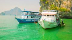 Phang-nga, thailand - circa feb 2014: passenger large boats near the rocks of Stock Footage