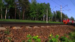 RZD Suburban train (russian railway). Camera near the rails. Stock Footage