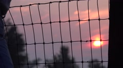 COWBOY RANCHER, fence  and the sun Stock Footage