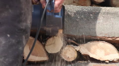 Man cutting wood logs with chainsaw, firewood for winter, close up - stock footage
