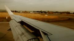 Airplane landing. arriving at airport. aircraft wing. runway. window view Stock Footage