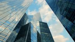 modern glass building background. time lapse. clouds moving - stock footage