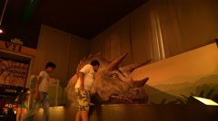 School children on a field trip to the museum. Dinosaur Exhibition Hall Stock Footage