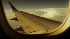 Flight flying. airborne. window view. wing. air traveling. trip tour Stock Footage