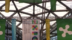 Milan, Expo 2015 and Regione Lombardia flags. Zoom out Stock Footage