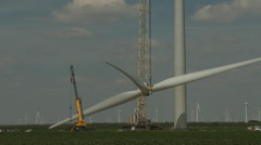 Wind turbine blades lifted 1 - stock footage