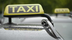 Yellow Taxi Sign On Car Stock Footage