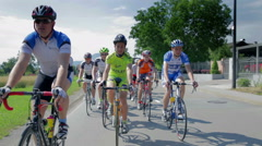 Driving in front of competing bicyclists Stock Footage