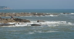 4k sparkling ocean sea water waves surface & coastal rock coast surge shore. Stock Footage